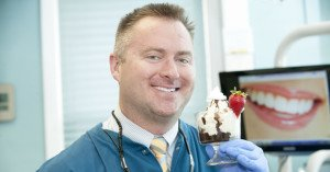 dr drews holding up an ice cream sundae